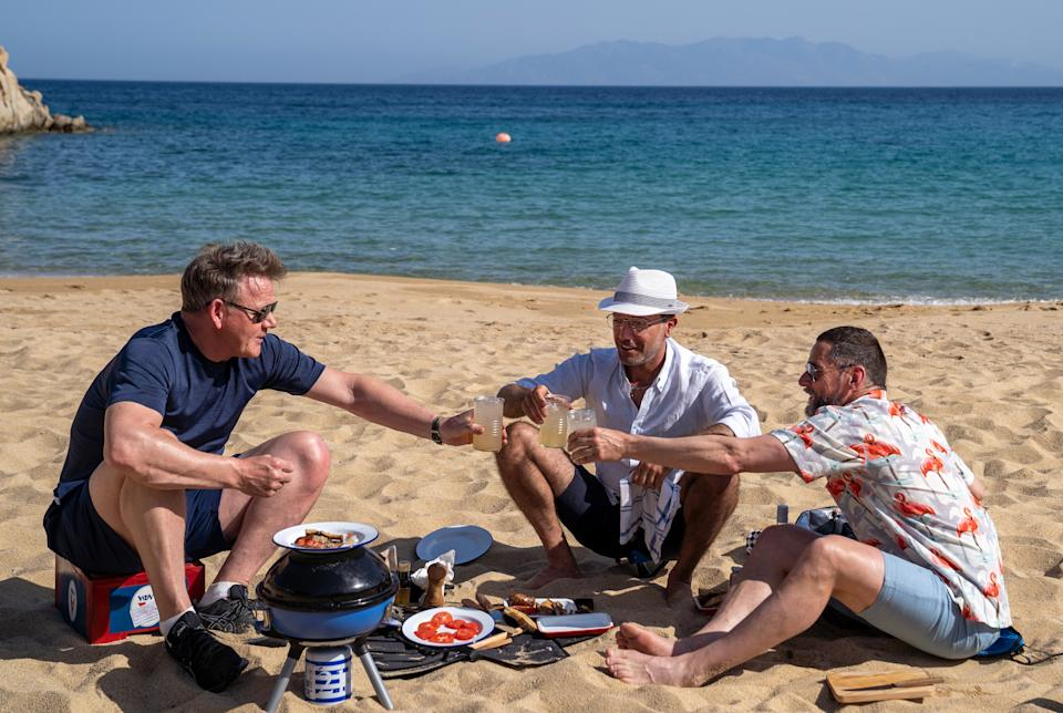 EMBARGOED PICTURE: FOR PUBLICATION FROM TUESDAY 21ST SEPTEMBER 20201 From Studio Ramsay   GORDON, GINO, FRED GO GREEK MAMMA MIA Monday 27th September 2021 on ITV   Pictured : Gordon Ramsay Gino D'Acampo and Fred Sirieix taste test the Mykonos sausage at a Barbecue on Paradise Beach.   Having previously traversed AmericaÕs west coast to explore flavours of the new world, this time out Gordon, Gino and Fred travel to Greece to immerse themselves in the culinary traditions and spectacular landscapes of the old world, in the birthplace of civilisation. The taste buddies embark on an island-hopping tour, keen to learn more about the Mediterranean diet and how the country has one of the healthiest populations in the world. GinoÕs right at home, declaring himself El Capitano and taking charge of their catamaran - stand by for a bumpy ride. Highlights include the boys hunting and cooking a unique species of lobster in Crete, touring the islands by tuk-tuk and jet ski, taking a mud bath in a volcanic spring in stunning Santorini, as well as chowing down on mouth-watering moussaka, and finally, tickling their taste buds with a hugely popular local speciality: the Mykonos sausage.  (C) Studio Ramsay  For further information please contact Peter Gray 07831 460 662 peter.gray@itv.com    This photograph is © Studio Ramsay and can only be reproduced for editorial purposes directly in connection with the  programme GORDON, GINO, FRED GO GREEKor ITV. Once made available by the ITV Picture Desk, this photograph can be reproduced once only up until the Transmission date and no reproduction fee will be charged. Any subsequent usage may incur a fee. This photograph must not be syndicated to any other publication or website, or permanently archived, without the express written permission of ITV Picture Desk. Full Terms and conditions are available on the website https://www.itv.com/presscentre/itvpictures/terms