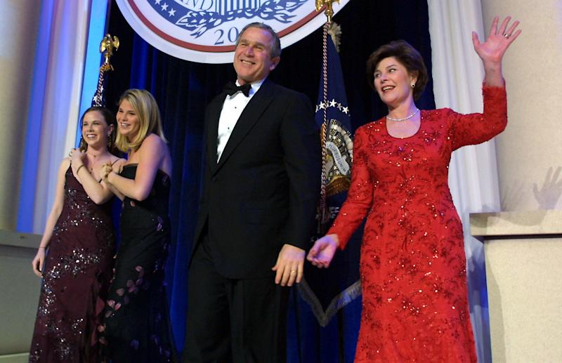 United States President George W. Bush (C), his wife Laura, and daughters Jenna and Barbara, attend the first inaugural ball in Washington, DC. (Brooks Kraft via Getty Images)