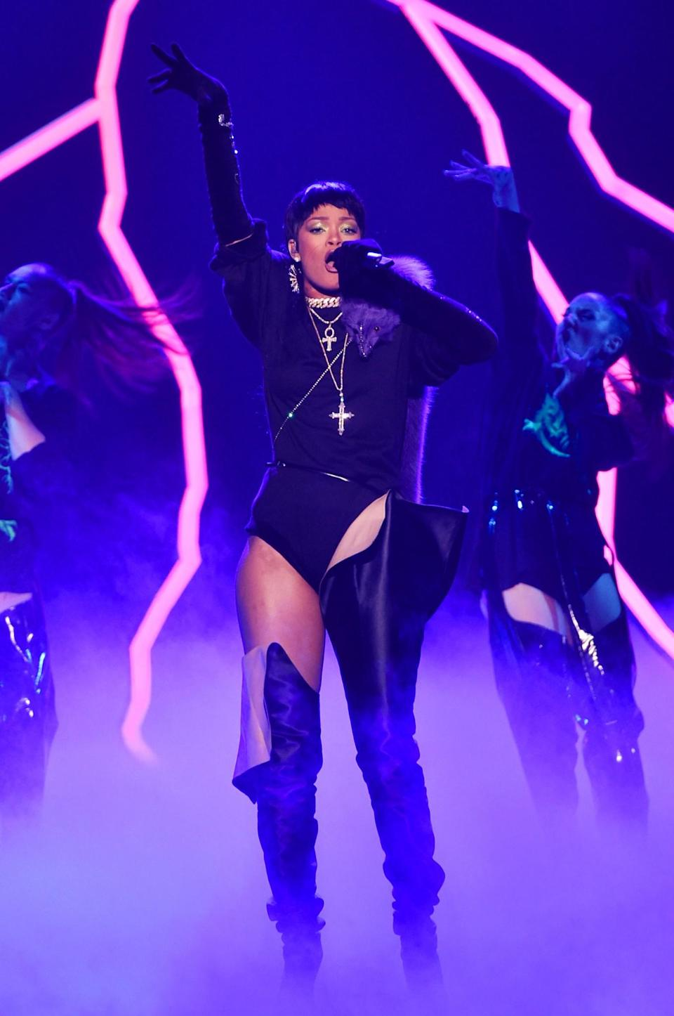 """<p>The song has sold 1,758,000 copies since its release in January. This is the year's top hit by a female lead artist. This is Rihanna's first appearance in a year-end top 10 since 2013, when """"Stay"""" (featuring Mikky Ekko) was the year's No. 10 hit. """"Work"""" was nominated for a Grammy for Record of the Year. (Photo by Getty Images) </p>"""