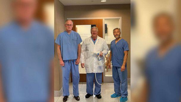 PHOTO: Dr. Todd Rumsey, center, holds the Cerene cryotherapy device used to help ease women's menstrual cycles. (Cameron Memorial Community Hospital)