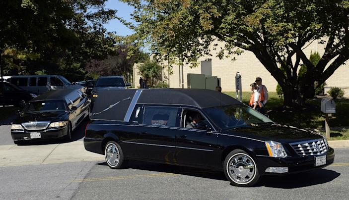 The hearse leaves the church at Good Shepherd Lutheran Church in Gaithersburg, Md., Tuesday, Sept. 24, 2013, following the funeral service for Navy Yard shooting victim John R. Johnson. (AP Photo/Susan Walsh)