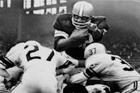 FILE - In this Oct. 2, 1960 file photo, Jim Brown sails over the line for a fourth quarter touchdown against the Pittsburgh Steelers, in Cleveland. Jim Brown only played until 1965 but his impact in the first six years of the '60s was enough to make him perhaps the most dominant player in the NFL during that period. (AP Photo)