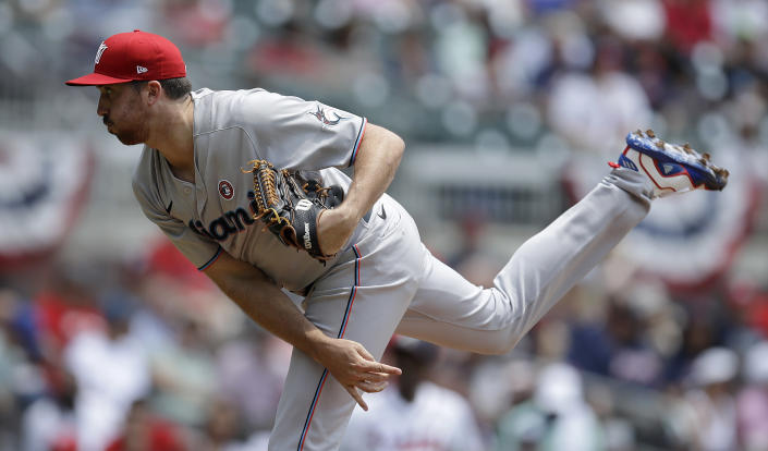 Miami Marlins pitcher Zach Thompson works against the Atlanta Braves in the first inning of a baseball game Sunday, July 4, 2021, in Atlanta. (AP Photo/Ben Margot)