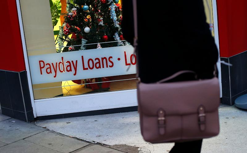 A payday loans sign is seen in the window