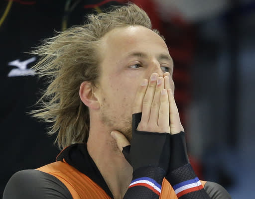 Gold medallist Michel Mulder from the Netherlands celebrates after his second heat race in the men's 500-meter speedskating race at the Adler Arena Skating Center during the 2014 Winter Olympics, Monday, Feb. 10, 2014, in Sochi, Russia. (AP Photo/Patrick Semansky)