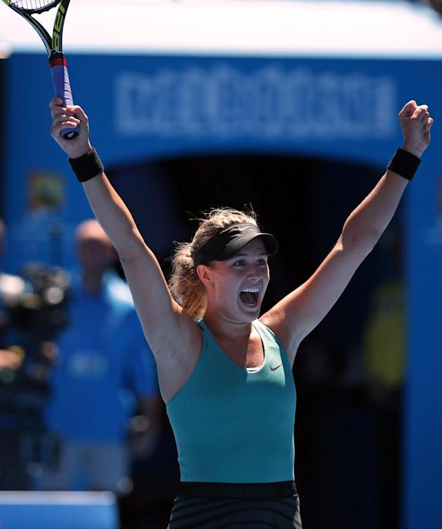 Eugenie Bouchard of Canada celebrates after defeating Ana Ivanovic of Serbia during their quarterfinal at the Australian Open tennis championship in Melbourne, Australia, Tuesday, Jan. 21, 2014. (AP Photo/Aaron Favila)