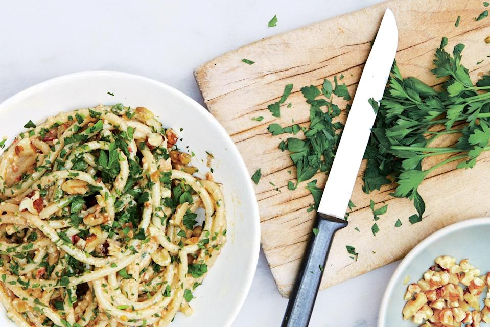 """Lots of walnuts, lots of parsley—this easy dinner recipe calls for ingredients you might already have on hand, meaning it's ideal for weeknight cooking. Its flavor, though, is anything but basic. <a href=""""https://www.epicurious.com/recipes/food/views/bucatini-with-walnut-parsley-pesto?mbid=synd_yahoo_rss"""" rel=""""nofollow noopener"""" target=""""_blank"""" data-ylk=""""slk:See recipe."""" class=""""link rapid-noclick-resp"""">See recipe.</a>"""