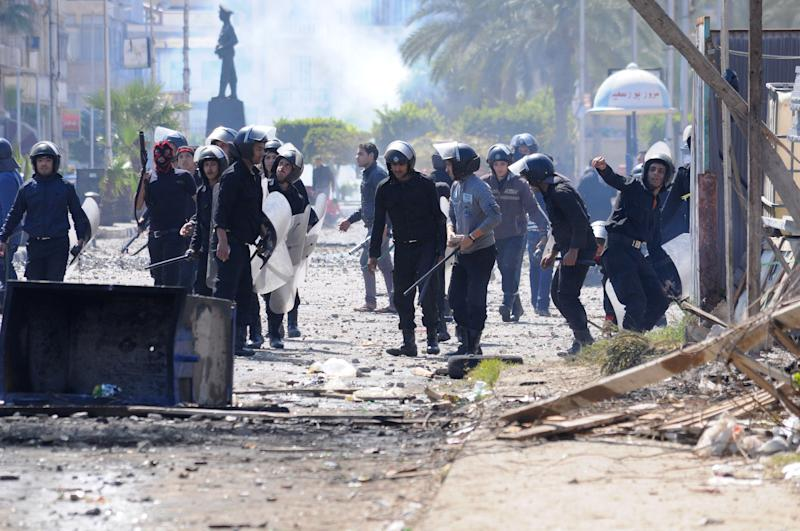 Riot police clash with protesters in Port Said, Egypt, Tuesday, March 5, 2013. Egypt's Islamist president is considering whether to give the military full control of the restive Suez Canal city of Port Said after days of deadly street clashes stoked by excessive use of force by riot police, officials said Tuesday.(AP Photo)