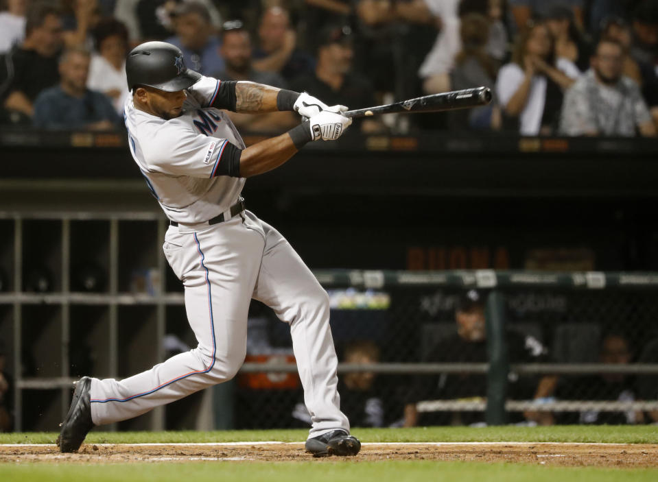 Miami Marlins' Cesar Puello hits a two-run home run off Chicago White Sox starting pitcher Reynaldo Lopez during the eighth inning of a baseball game Wednesday, July 24, 2019, in Chicago. Harold Ramirez also scored. (AP Photo/Charles Rex Arbogast)