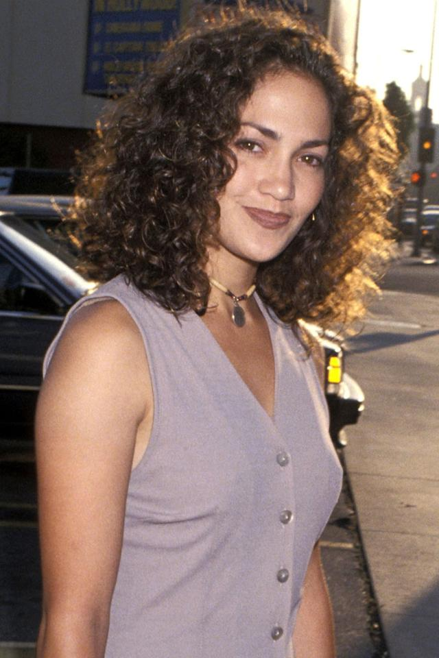 <p>Natural curls and a brick-red lipstick back in 1994. </p>