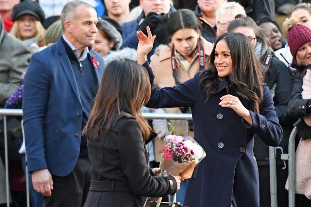 Prince Harry and Ms Markle split up to chat with people lining both sides of the route (Victoria Jones/PA)