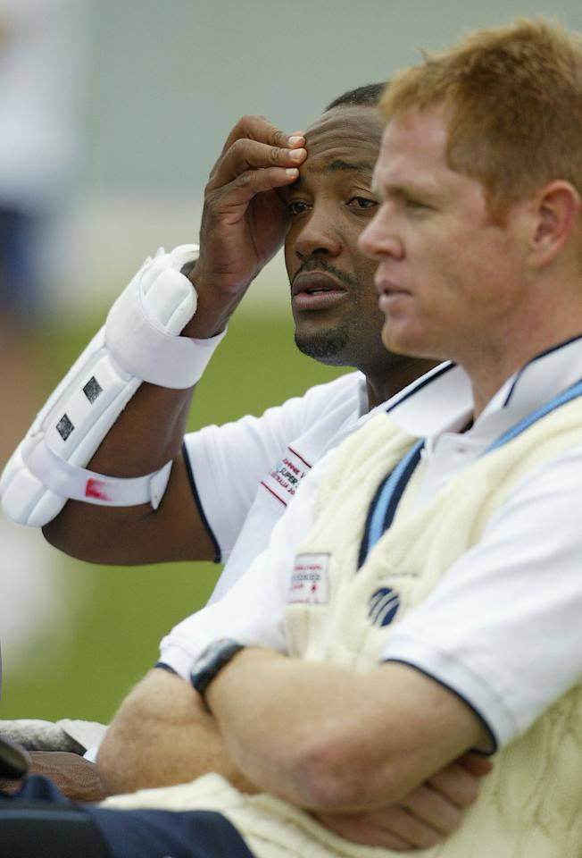 SYDNEY, AUSTRALIA - OCTOBER 12: Brian Lara and Shaun Pollock of the ICC World XI take a break during training at the Sydney Cricket Ground on October 11, 2005 in Sydney, Australia. (Photo by Mark Nolan/Getty Images)