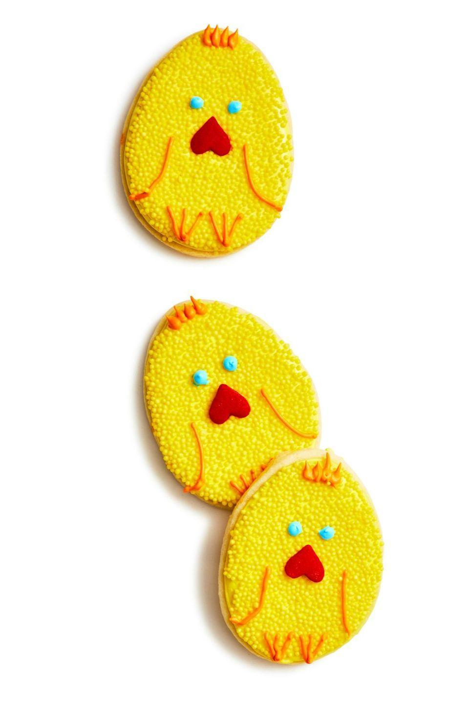 """<p>These adorable cookies are easy to make, and your little ones will love decorating each one with its own cute face and fun features. </p><p><strong><em><a href=""""https://www.womansday.com/food-recipes/food-drinks/a19156849/cookie-chicks-recipe/"""" rel=""""nofollow noopener"""" target=""""_blank"""" data-ylk=""""slk:Get the Cookie Chicks recipe."""" class=""""link rapid-noclick-resp"""">Get the Cookie Chicks recipe. </a></em></strong></p>"""