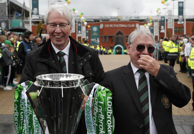 "Britain Football Soccer - Celtic v Heart of Midlothian - Scottish Premiership - Celtic Park - 21/5/17 Jim Craig and Willie Wallace (R) with the Scottish Premiership Trophy outside the stadium before the match Reuters / Russell Cheyne Livepic EDITORIAL USE ONLY. No use with unauthorized audio, video, data, fixture lists, club/league logos or ""live"" services. Online in-match use limited to 45 images, no video emulation. No use in betting, games or single club/league/player publications. Please contact your account representative for further details."