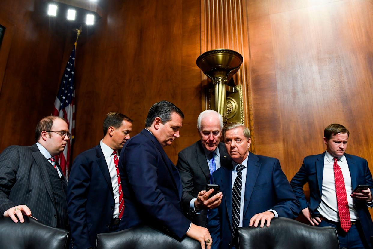 (Third, fourth and fifth from left) Sen. Ted Cruz (R-Texas), Sen. John Cornyn (R-Texas) and Sen. Lindsey Graham (R-S.C.) with staffers at the hearing.
