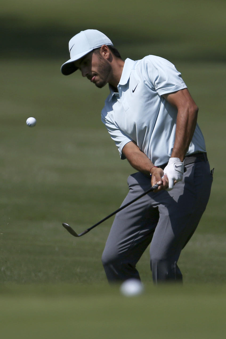 Mexican golfer Abraham Ancer approaches the green on the 2nd hole during the first round of the Mexico Championship at the Chapultepec Golf Club in Mexico City, Thursday, March 1, 2018. (AP Photo/Marco Ugarte)