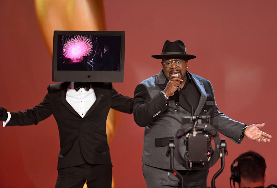 Host Cedric the Entertainer rapped as part of the Emmy Awards' opening number.