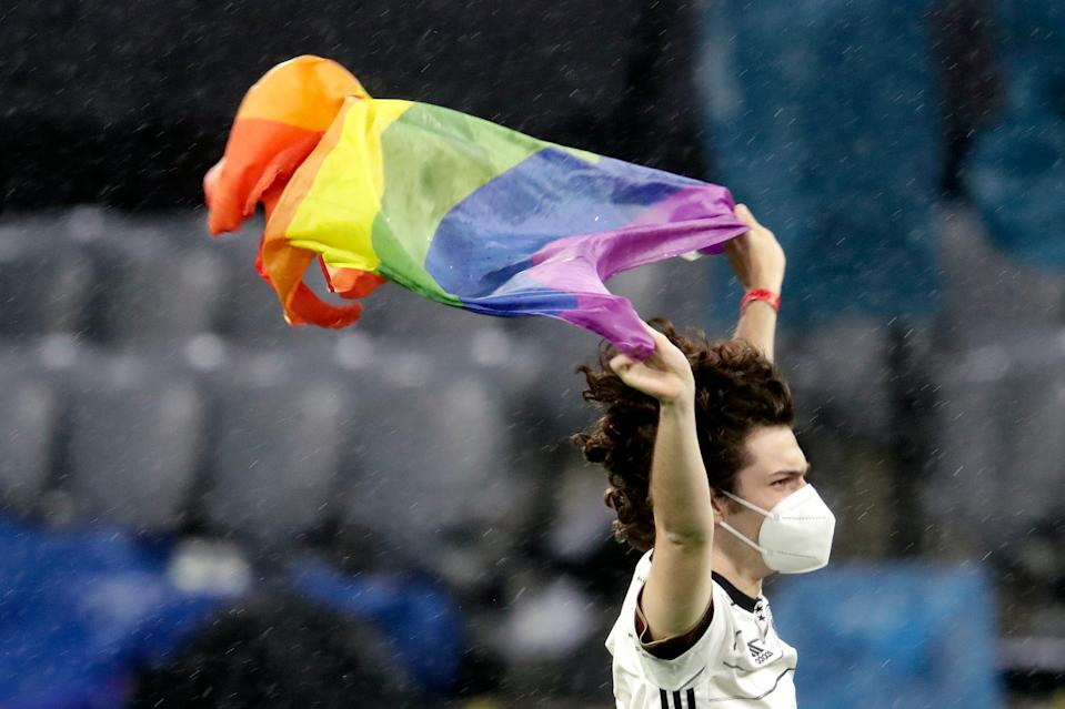 A Germany fan displays a rainbow flag before a Euro 2020 match against Hungary. (Photo by Laurens Lindhout/Soccrates/Getty Images)