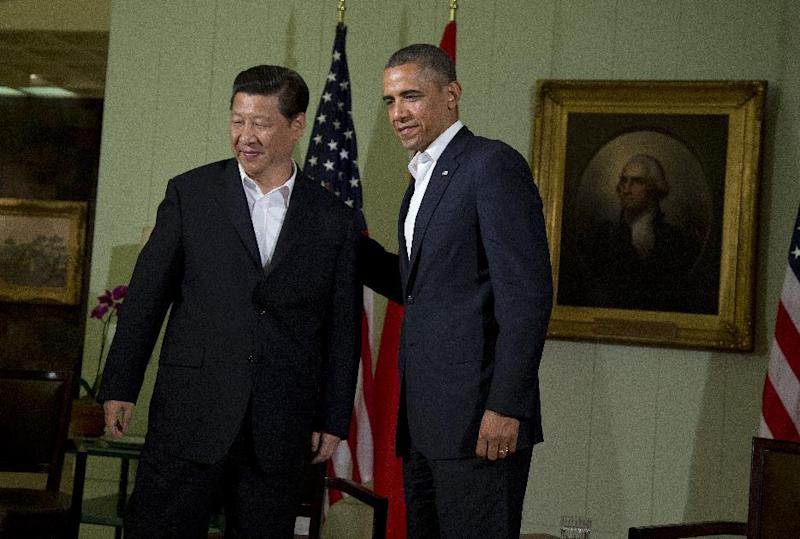 President Barack Obama, right, meets with Chinese President Xi Jinping at the Annenberg Retreat at Sunnylands Friday, June 7, 2013, in Rancho Mirage, Calif. Seeking a fresh start to a complex relationship, the leaders are retreating to a sprawling desert estate for two days of talks on high-stakes issues, including cybersecurity and North Korea's nuclear threats. (AP Photo/Evan Vucci)