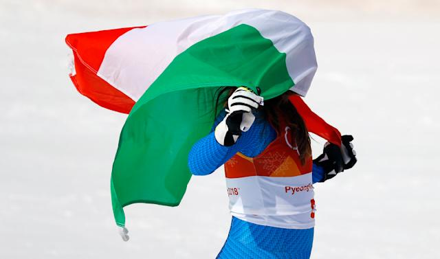 Alpine Skiing - Pyeongchang 2018 Winter Olympics - Women's Downhill - Jeongseon Alpine Centre - Pyeongchang, South Korea - February 21, 2018 - Gold medallist Sofia Goggia of Italy celebrates with the Italian flag during the flower ceremony. REUTERS/Leonhard Foeger TPX IMAGES OF THE DAY