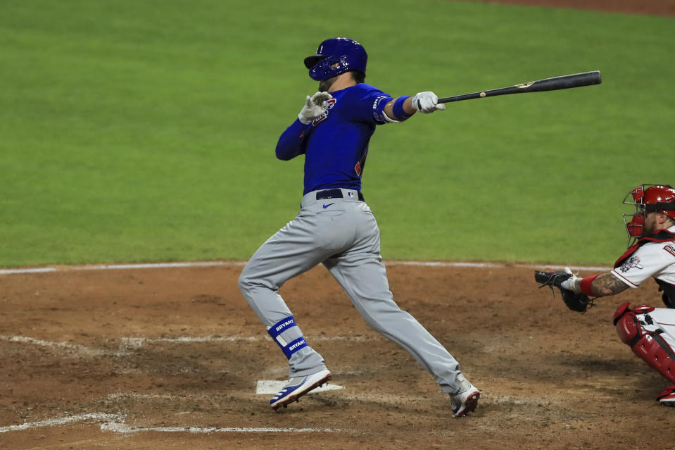 Chicago Cubs' Kris Bryant hits a two-run RBI double in the seventh inning during a baseball game against the Cincinnati Reds in Cincinnati, Wednesday, July 29, 2020. (AP Photo/Aaron Doster)