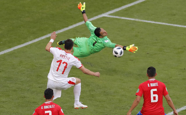 Serbia's Filip Kostic , left, tries to score past Costa Rica goalkeeper Keylor Navas during the group E match between Costa Rica and Serbia at the 2018 soccer World Cup in the Samara Arena in Samara, Russia, Sunday, June 17, 2018. (AP Photo/Vadim Ghirda)