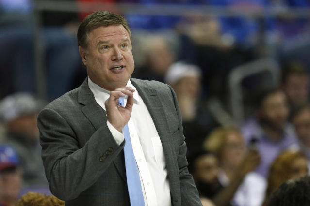 FILE - In this Feb. 8, 2020, file photo, Kansas head coach Bill Self reacts to a play as Kansas plays TCU during the second half of an NCAA college basketball game in Fort Worth, Texas. The outbreak of the coronavirus brought the sports world the whole world, really to a screeching halt, and that includes the crucial recruiting period for college coaches that were putting the finishing touches on their 2020 classes while laying the all-important groundwork for next year's classes. (AP Photo/Ron Jenkins, Fle)