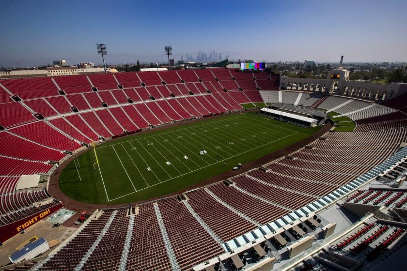 Brian van der BrugLos Angeles Times USC OFFICIALS additional concession stands, improved footing on stairs and a cupholder at every seat. Capacity was reduced from 92,348 to 77,500.