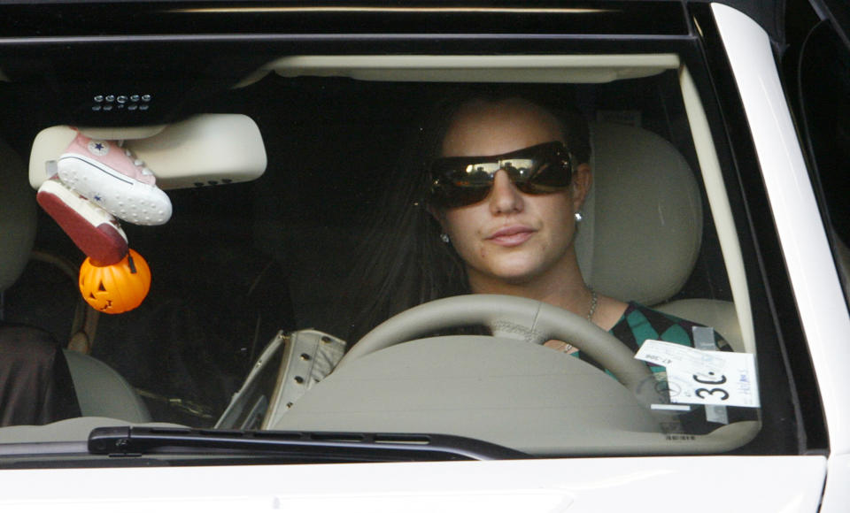 Britney Spears drives her Mercedes Benz  as she leaves the Stanley Mosk Courthouse garage after a child custody hearing with her ex-husband regarding her two sons in Los Angeles, California October 26, 2007.  REUTERS/Fred Prouser     (UNITED STATES)