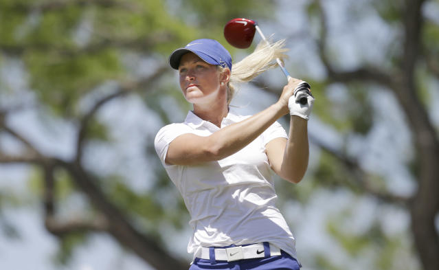 Suzann Pettersen, of Norway, watches her tee shot on the first hole during the final round of the North Texas LPGA Shootout golf tournament at Las Colinas Country Club in Irving, Texas, Sunday, May 4, 2014. (AP Photo/LM Otero)
