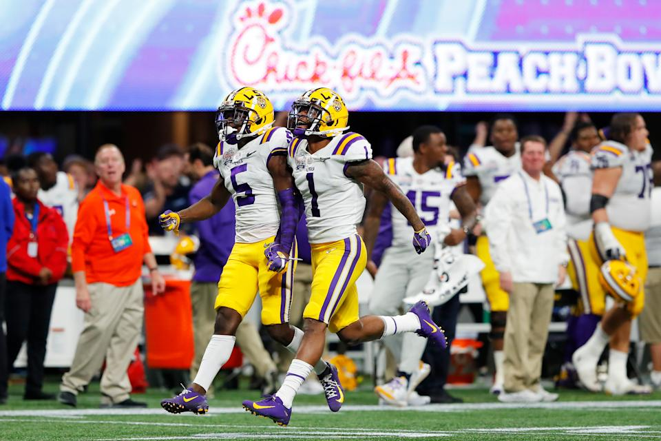 ATLANTA, GEORGIA - DECEMBER 28:  Devonta Lee #5 of the LSU Tigers and  Kristian Fulton #1 celebrate an interception over the Oklahoma Sooners during the Chick-fil-A Peach Bowl at Mercedes-Benz Stadium on December 28, 2019 in Atlanta, Georgia. (Photo by Kevin C. Cox/Getty Images)