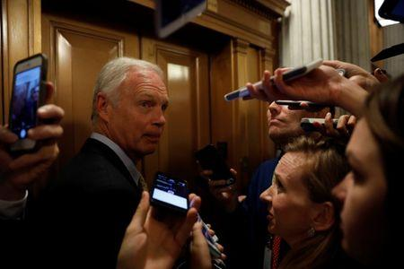 """FILE PHOTO: Senator Ron Johnson (R-WI) speaks with reporters after the failure of the """"skinny repeal"""" health care bill on Capitol Hill in Washington, U.S., July 28, 2017. REUTERS/Aaron P. Bernstein"""