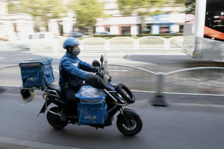 Uniformed drivers have remained among the most visible sights on otherwise emptied streets in China