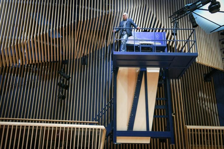 Pianists must climb a looming climb up the steep steel stairs to reach the keys (AFP Photo/Ilmars ZNOTINS)