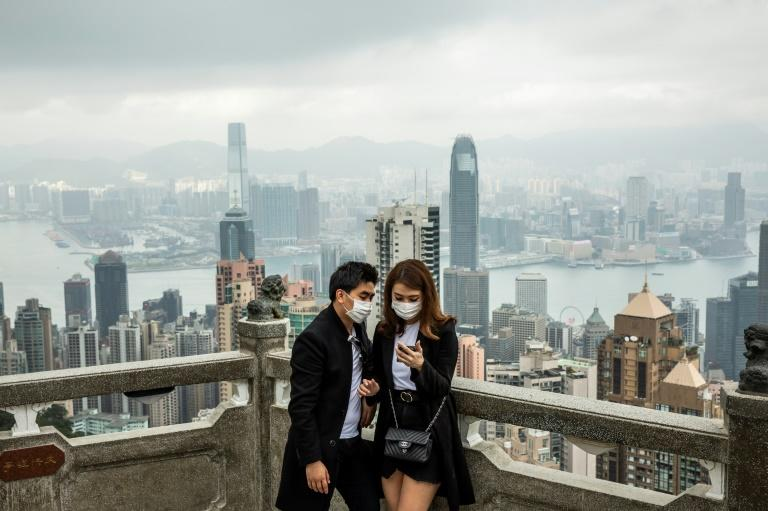 The coronavirus outbreak is the latest blow to Hong Kong's economy, which was already reeling from political turmoil and the US-China trade war (AFP Photo/ISAAC LAWRENCE)