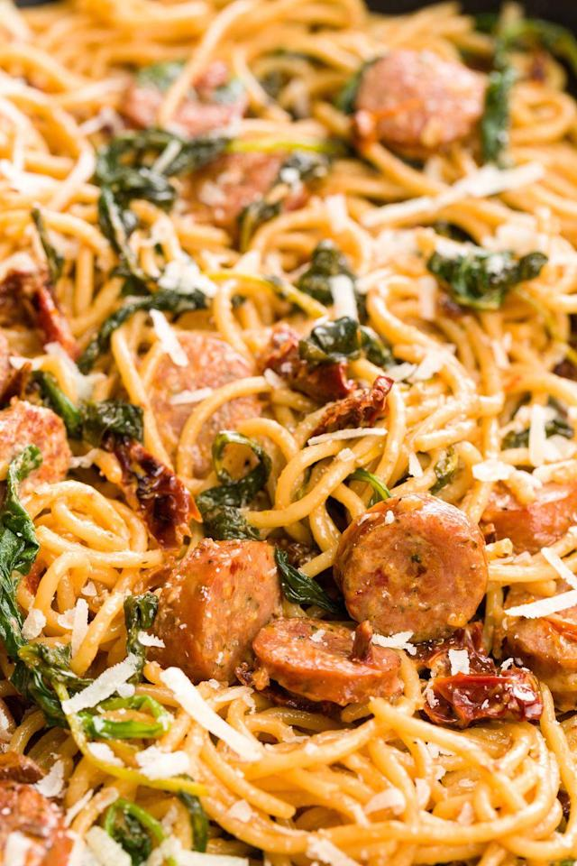 """<p>This meaty spaghetti in a cream sauce is the whole package for an easy dinner.</p><p>Get the recipe from <a href=""""https://www.delish.com/cooking/recipe-ideas/recipes/a45764/spaghetti-with-sun-dried-tomatoes-sausage-and-spinach-recipe/"""" rel=""""nofollow noopener"""" target=""""_blank"""" data-ylk=""""slk:Delish"""" class=""""link rapid-noclick-resp"""">Delish</a>.</p>"""