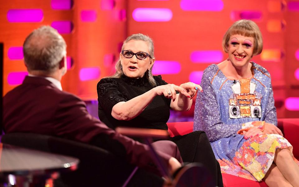 Carrie Fisher and Grayson Perry appearing on Graham Norton's sofa in 2016 - BBC