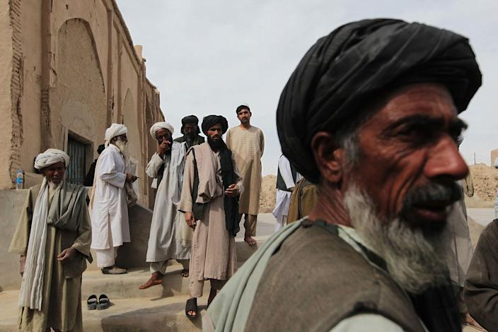 <p>Tribal elders and mullahs from both Pashtun and Balouchi tribes prevalent in southern Helmand province gather after praying together at a rural mosque March 12, 2010 in Khan Neshin in Helmand Province, Afghanistan. A group of local tribal and religious leaders were brought together to a nearby US Marine base for a shura meeting between themselves and American troops, and then afterward gathered in the local mosque to pray. (Photo by Chris Hondros/Getty Images) </p>