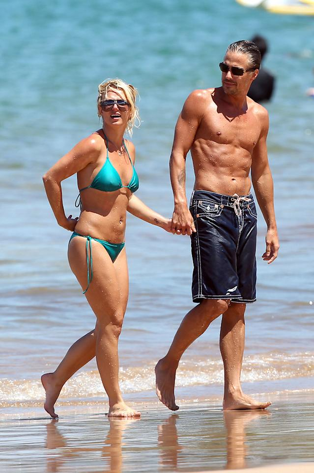 "Hollywoodlife reports that Britney Spears' boyfriend, Jason Trawick, ""proposed to her during their recent Hawaiian vacation -- and that she said YES!"" For all the details, including what Spears herself says about the romantic proposal, log on to <a href=""http://www.gossipcop.com/britney-spears-jason-trawick-hawaii-proposed-proposal-engaged-engagement/"" target=""new"">Gossip Cop</a>. <a href=""http://www.pacificcoastnews.com/"" target=""new"">PacificCoastNews.com</a> - August 25, 2010"