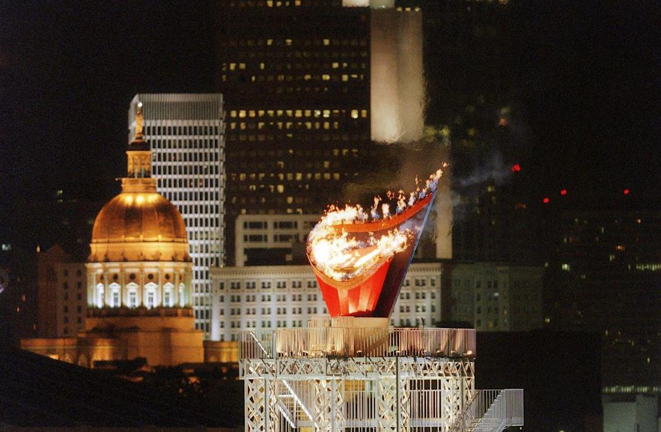 <p>The cauldron that contains the Olympic flame is as remarkable as the fiery display. Each host country is given artistic discretion to design the cauldron. Here, the Olympic flame is photographed high amidst the Atlanta skyline during the opening ceremony for the 1996 Summer Olympic Games.</p>