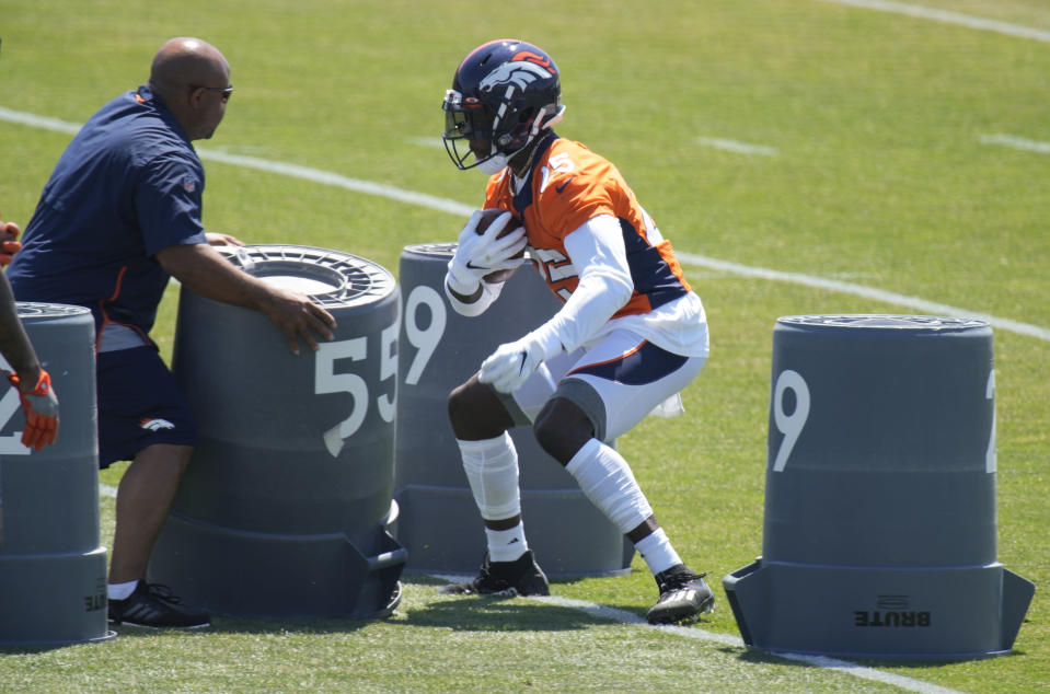 Denver Broncos running back Melvin Gordon, right, takes part in drills during a mandatory minicamp at the NFL team's training headquarters Tuesday, June 15, 2021, in Englewood, Colo. (AP Photo/David Zalubowski)