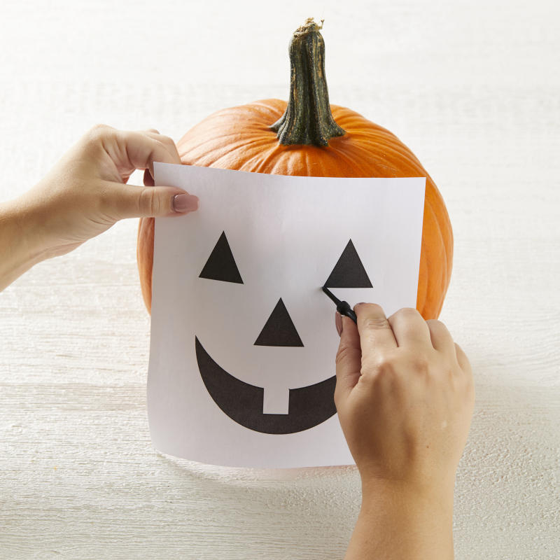 How to outline a pumpkin stencil on a jack-o-lantern