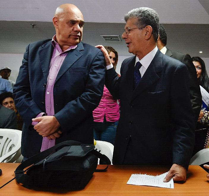 "The president of the Venezuelan National Assembly, Henry Ramos Allup (R) and the secretary general of the opposition Democratic Unity Roundtable (MUD), Jesus ""Chuo"" Torrealba, arrive in Caracas on May 31, 2016 after the OAS calls an ""urgent meeting"" (AFP Photo/Juan Barreto)"