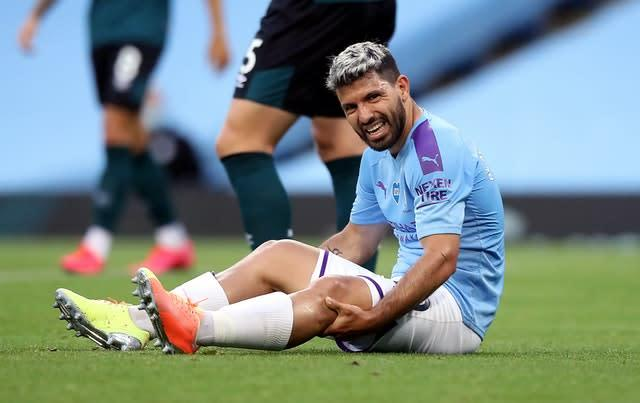 Sergio Aguero was forced off with a knee injury (Martin Rickett/PA)