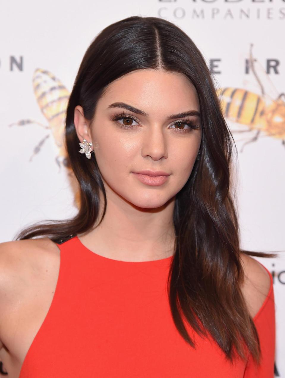 <p>At the Fragrance Foundation Awards in New York City, Jenner kept her makeup minimal with enviably shiny brunette locks. <i>(Photo: Getty Images)</i></p>