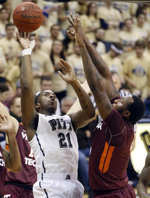 Pittsburgh's Lamar Patterson (21) tries a shot over Virginia Tech's Cadarian Raines during the first half of an NCAA college basketball game on Saturday, Feb. 8, 2014, in Pittsburgh. (AP Photo/Keith Srakocic)