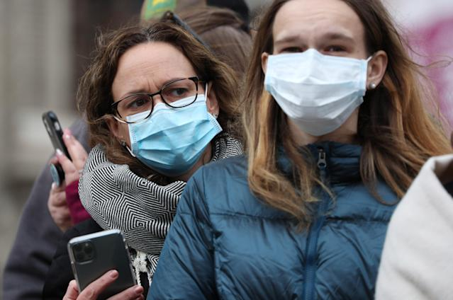 People wearing masks to protect against coronavirus in central London (PA Images via Getty Images)