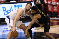 Los Angeles Clippers center Ivica Zubac (40) works in against Toronto Raptors center Khem Birch (24) during the second half of an NBA basketball game Tuesday, May 11, 2021, in Tampa, Fla. (AP Photo/Chris O'Meara)
