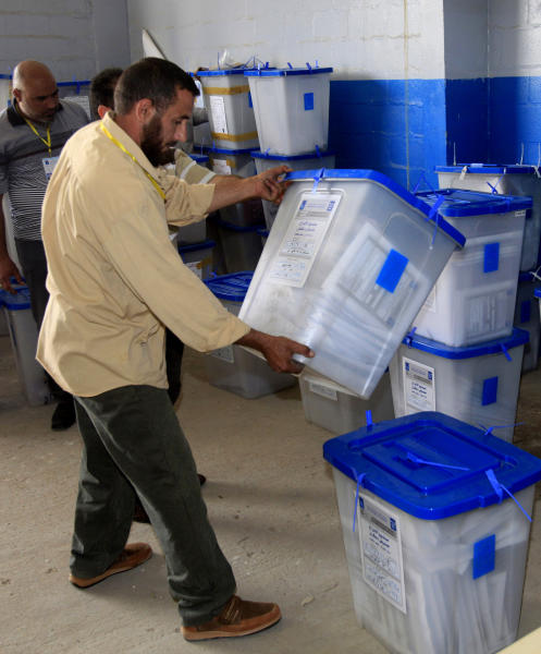 Electoral workers inspect ballot boxes at a counting center in Baghdad, Iraq, Sunday, April 21, 2013. Iraqis have begun counting votes from the first provincial elections since the last U.S. troops withdrew in December 2011. (AP Photo/ Karim Kadim)