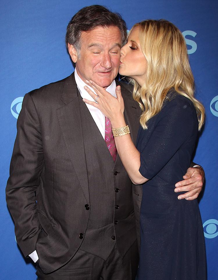 "We don't know where Sarah Michelle Gellar's hubby Freddy Prinze Jr. was that night, but the 36-year-old happily planted a wet one on the cheek of Robin Williams at the 2013 CBS Upfronts at Manhattan's Lincoln Center on Wednesday. Williams and Gellar are starring together in the upcoming TV series ""The Crazy Ones."" (5/15/2013)"